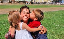 Happy mom and kids stock photo