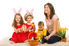 Happy mom and kids prepare for Easter Stock Photos