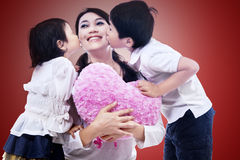 Happy mom kissed by children Royalty Free Stock Image
