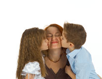 Happy mom kissed by children Royalty Free Stock Photography