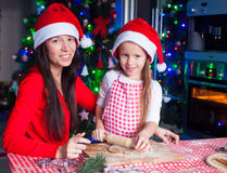 Happy mom and little girl baking Christmas Stock Photos