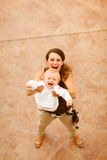 Happy mom playing with baby  on street Stock Photos
