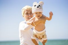 Motherhood. Mom joyfully spending time with her baby boy. royalty free stock images