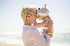 Motherhood. Mom joyfully spending time with her baby boy. stock photo