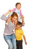 Happy mom playing with her kids. Happy mom having fun with her kids isolated on white background Royalty Free Stock Photo