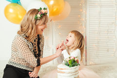 Happy mom playing with her little daughter. Birthday concept. Mother`s day concept.