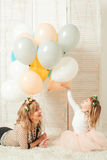 Happy mom playing with her little daughter. Birthday concept. Mother`s day concept. Stock Photo