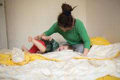 Happy mom playing with her son in bed  a relaxed morning Stock Photo