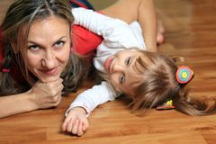 Happy mom plays with her daughter Royalty Free Stock Image
