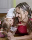 Happy mom plays with her daughter Stock Image