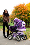Happy mom with pram Royalty Free Stock Photography