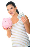 Happy Mom Saving Money. Save money concept. a woman holding pink piggybank and money. isolated stock photos