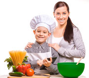 Happy mom and som are cooking on the kitchen Royalty Free Stock Images