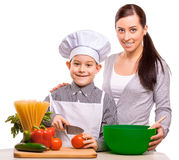 Happy mom and som are cooking in the kitchen Royalty Free Stock Photos