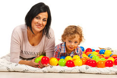 Happy mom and son with colorful balls Royalty Free Stock Photos