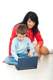 Happy mom and son with notebook Royalty Free Stock Photo