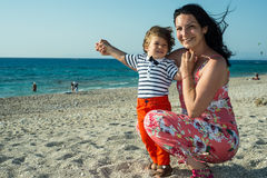 Happy mom and son with open arms in the wind Royalty Free Stock Images