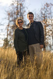Happy mom and son smiling outdoors in sun. Shine in park setting Stock Photos