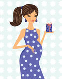 Happy mom-to-be holding a little gift box Royalty Free Stock Photography