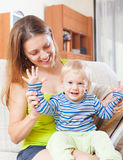 Happy mom with toddler Stock Images