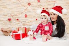 Happy mom with Toddler Santa Royalty Free Stock Photo