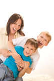 Happy mom with two children Royalty Free Stock Images