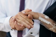 Closeup view of married couple holding hands Royalty Free Stock Photos