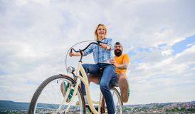 Happy moments. Active leisure tips. Summer holidays ideas. Enjoy summer holidays vacation riding bike. Youth have fun. Riding bike sky background. Couple in royalty free stock image