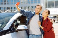Cheerful happy couple taking selfies royalty free stock photos