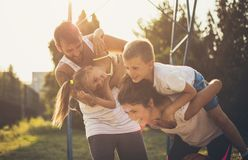 Happy moments. Family on playground stock image