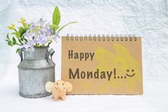 Happy monday greeting card concept. Happy elephant clay doll and flower pot with greeting card royalty free stock photos