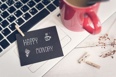 Happy Monday massage on notebook with coffee. Happy Monday massage on notebook with cup of coffee and flower on wooden table royalty free stock images