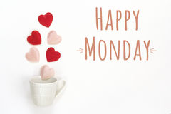 Happy Monday message and coffee cup with hearts coming out of it Royalty Free Stock Photo
