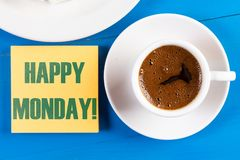Happy Monday Text Concept With Cup Of Coffee On The Table.  stock photo