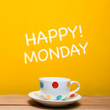 Happy monday word with coffee cup. On yellow background Stock Photo