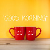 Happy Monday word.Two cups of coffee and stand together Royalty Free Stock Images