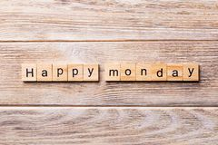 Happy Monday word written on wood block. Happy Monday text on wooden table for your desing, concept.  stock image