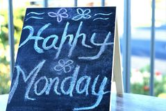 Happy Monday written with chalk on blackboard. Black signboard with positive thought `Happy Monday` at Cafe`. Selective focus. Motivational concept royalty free stock photo