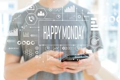 Happy Monday with man using a smartphone. Happy Monday with young man using a smartphone royalty free stock photography