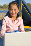 Happy Mongolian Girls Laptop Campsite Concept Royalty Free Stock Photography
