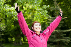 Happy mongolian woman likes sport Stock Images