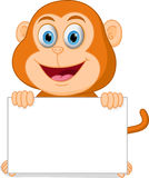 Happy monkey cartoon with sign Royalty Free Stock Image