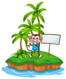 A happy monkey in the island with an empty signboard Stock Images