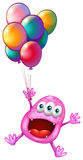 A happy monster with balloons Stock Images