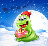 A happy monster with a cake Royalty Free Stock Images
