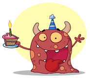 Happy monster celebrates birthday with cake Stock Photos