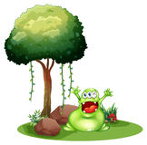 A happy monster near the tree Royalty Free Stock Photo