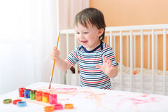 Happy 20 months baby boy painting Royalty Free Stock Photo