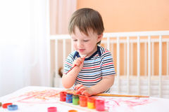 Happy 20 months baby painting at home Royalty Free Stock Photos