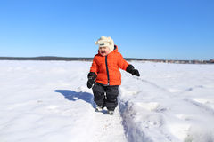 Happy 18 months baby walking in winter Stock Photography